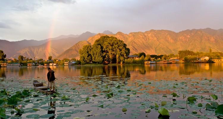 Sunset baths Nageen Lake in a golden light after a monsoon storm.